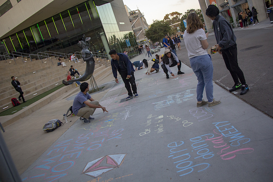 Students chalk sidewalk near Price Center